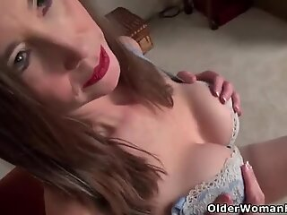 American milf Lilly James takes off her dress and rubs one out