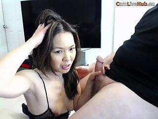 hot milf korean babe milks a white cock on cam