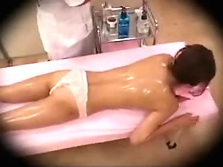 Irresistible Japanese lady lies on the massage table and ge