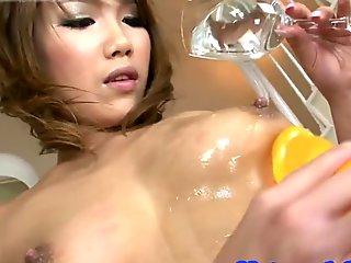 Oiledup oriental milf plays with toys