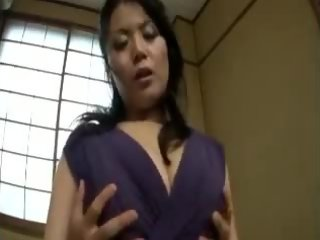 Big breasted Oriental milf in pantyhose is on the prowl for