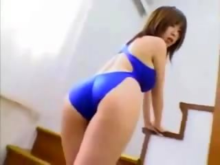 Sexy asian girl teases in blue swimsuit