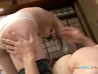 Sexy Japanese MILF is sucking a big cock