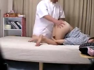 Lovely Asian babe with a spicy ass has a masseur pleasing h