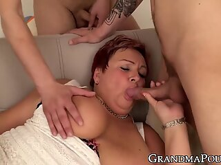 Chubby redhead granny munching on cock while pussy fingered