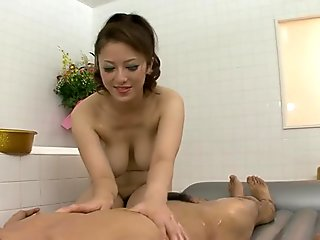 Busty milk skinned Japanese milf Meisa Hanai gives slippery massage