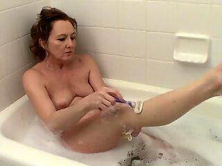 Wife washing while waiting for husband
