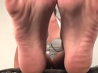 Teased by Asian girl showing off her big feet
