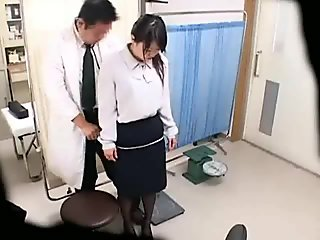 Cute Asian girl is strapped to an examination table and gets her ass fucked with a toy