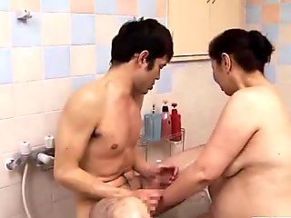 Cute Asian 18yo gives a bathroom blowjob