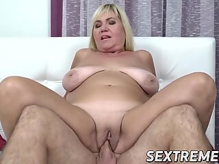 Mature Pam Pink makes young cock spill its load
