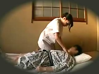 Horny Japanese masseuse seduces a client to fulfill her sex